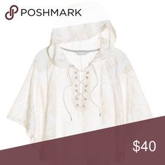 VS Lace-Up Poncho New in online packaging! Beautiful white poncho with a white palm burnout print! A lace-up neck and hood are added features that make this a must have piece for your wardrobe!!💞 Victoria's Secret Sweaters Shrugs & Ponchos