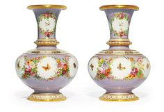 A Pair Of Porcelain Vases From The Property Of Grand Duchess Olga Nikolaevna<br />by the Imperial Porcelain Factory, St Petersburg, <i>circa</i> 1860 <br />Each spherical with a tall tapering neck and flared rim, on conforming foot, the lilac ground body decorated with six white ground cartouches, framed within multi-coloured flowers, the neck decorated with three cartouches, each cartouche containing a multi-coloured butterfly, dragonfly or bee, the foot, rim and moulded band on the lower…