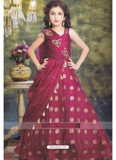 A Magenta color Silk floor length Gown for Kids. It features pleated layered pattern adorned with fancy tassels for a smart look. It has zari motifs and embroidery work on it. Kids Party Wear Dresses, Baby Girl Party Dresses, Dresses Kids Girl, Kids Outfits, Prom Dresses, Frocks For Girls, Gowns For Girls, Kids Party Frocks, Kids Indian Wear