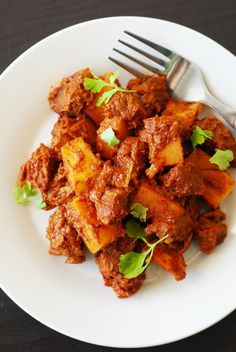 Lamb Vindaloo from A Duck's Oven. A spicy and flavorful meal that can be cooked on the stove or in a Dutch oven.