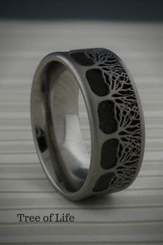 Flat profile Tree of Life Wedding Ring Laser carved Tree design. Design is continuous around the entire ring. Choice of mm width and finish. Comfort Fit. Made in the UK.