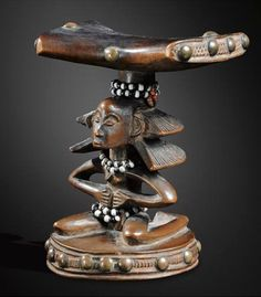 "Africa | Headrest from the Luba Shankadi people of from the small Kinkondia kingdom, situated close to Lake Kisale in the Shaba region of DR Congo | Wood, brass tacks and glass beads | ca. late 19th to early 20th century. Sold: 1,524,000 EUR. Attributed to the great Luba-Shaba 'miniaturist' (the works never exceed more than 20 cm) known as the ""Maître de la coiffure en cascade / Master of the Cascade Coiffure"" Kinkondja workshop"