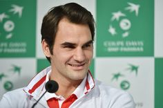 Swiss Davis Cup team player Roger Federer speaks during a press conference on November 18, 2014 in Villeneuve-d'Ascq, northern France, prior to the Davis Cup tennis tournament final against France on November 21-23, 2014. Switzerland's hopes of a first ever Davis Cup win lay in the balance as the team awaited word on just how badly Roger Federer had injured his back ahead of this week's final against France in Lille