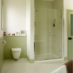 alcove shower, hanging toilet, shelf above toilet