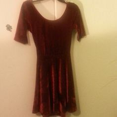 Red Backless Velvet Dress Super cute and flirty. Wore once for a christmas party. Its a M on the tag but I sewed the back to fit an xs/s waist. Its very stretchy though. No defects or stains Dresses