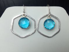 brushed silver hexagon hoop earrings with a by MiiMyxJewelry, $36.00