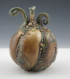 Carol Long | Bottle  another that could be done with a gourd and polyclay - at least I think so...