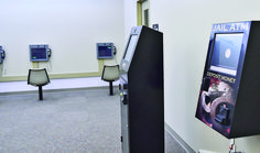 ATM in the lobby at the Shelby County Jail allows visitors to send money to inmates. Along the wall in the lobby are video conferencing stations for visitation with inmates