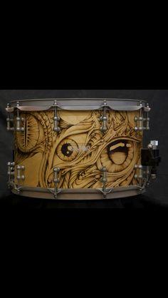 Cool hand wood-burned drum by Savior Custom Drums.
