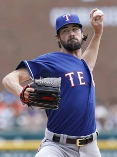 Texas Rangers' Cole Hamels pitches against the Detroit Tigers during the first inning of a baseball game at Comerica Park, Sunday, Aug. 23, 2015, in Detroit. (AP Photo/Duane Burleson)
