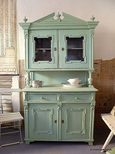 Antique green European cupboard.