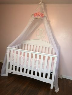 DIY floral canopy pink and white baby girl nursery