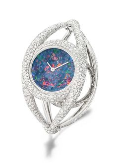 Piaget's Extremely Piaget cuff watch, set with 1,699 brilliant-cut white diamonds surrounding an opal dial, houses a Piaget 56P quartz movement.