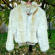 1.99 Shipping!! Genuine Vintage Rabbit Fur Coat!! Absolutely gorgeous!! In excellent condition other than a small stain inside, but it will probably come out if you have it dry-cleaned! Banding around the bottom and sleeves! Very modern looking! Please feel free to send me a reasonable offer!! Vintage Jackets & Coats