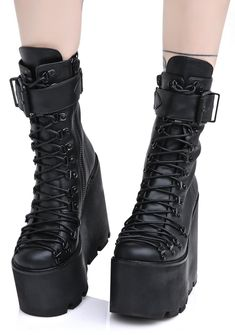 Current Mood Traitor Boots cuz once ya do a double-cross, ya gotta be ready to fight! These gnarly platform boots feature a sleek black vegan leather construction, ultra high wedge heel 'N platform with cutout tread, laces that run all the way down to tha tow, matte black hardware, wrapped calf strap with adjustable buckle, and side zip closures.
