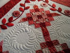 Over the top quilting on this red and white quilt - WOW