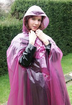 Lorraine Ward in a purple cape with nice buttons Vinyl Raincoat, Plastic Raincoat, Pvc Raincoat, Hooded Raincoat, Lorraine, Capes, Rain Bonnet, Rain Suit, Bronze
