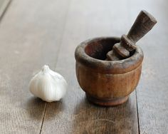 TREEN..... NICE LITTLE EXAMPLE OF A SMALL MORTAR AND PESTLE. THIS WAS PROBABLY USED IN THE KITCHEN TO CRUSH HERBS.......