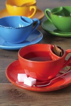 ~ a cup with a tea bag holder in it...  I totally want one of these! This is such a great idea!.