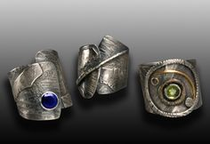 Rings | Wendy Thurlow. 'Wrapped Trio'. Textured & oxidized silver with sapphire and peridot.