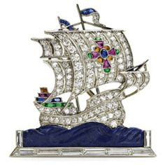 Platinum and diamond gem-set brooch of a tall ship, with a carved lapis lazuli sea.    by J.E. Caldwell.   American, 1930