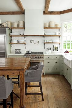 Love the wide pine floors, eat-in kitchen & open shelving. Very homey, yet stylish.