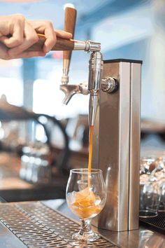 At coffee shops, the icy brew is usually stored in a keg, pressurized, and poured from a tap: | Here's Everything You Need To Know About Nitro Coffee