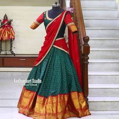 Bridal Kanjivaram half saree collection . Stunning bottle green color lehenga and blouse with red color net dupatta. Lehenga with gold jari boarder.This out fit is Availble from house of Kadhambari Studio. They can customize the colour and size as per your requirement. THey have international shipping service too. For Orders    Enquirys Reach on WhatsApp +91 880187647 . 11 March 2019 Half Saree Lehenga, Green Lehenga, Lehenga Blouse, Saree Blouse Patterns, Saree Blouse Designs, Traditional Blouse Designs, Kanjivaram Sarees Silk, Rajasthani Dress, Half Saree Designs