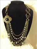 Drop layer necklace with chain strands and flower and rhinestone accent