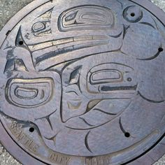 Seattle. Washington - 4th and Union:  Nathan Jackson was commissioned in 1976, and produced a Tlingit whale relief, originally carved in wood and later cast in iron. Thirty-two of these hatchcovers were made, ranging in diameter from 32 inches to 36 inches.