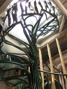 Hand forged spiral stair case- LOOK at that!!!  Visit stonecountyironworks.com for more amazing wrought iron designs!