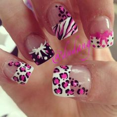 I love these nails! Had mine done similar but no bows n with purple n black.