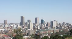 Economics- This is a view from Downtown Johannesburg, South Africa. This is home to many office buildings. Pretoria, Cheapest Places To Live, Treading Water, African Countries, Places Around The World, Outdoor Travel, San Francisco Skyline, South Africa, The Good Place