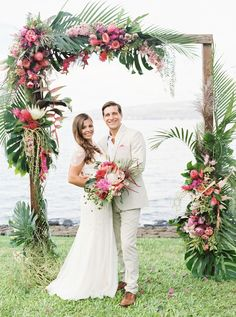 Floral Arch Hawaiian Wedding Decoration. Pink and Green Flower Arch Decorations. Oceanfront Hawaii Wedding.