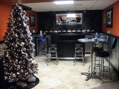 Harley Man Cave, This is my husbands ode to Harley Davidson/Crown Royal Man Cave., this was taken at christmas time. We have a black harley davidson themed christmas tree. Each year I add to it., Basements Design