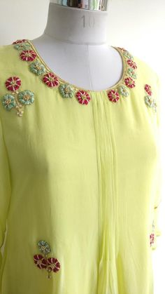 Description: Colourful zardozi handwork motifs all-over the front A-line pattern with sleeves Pi Embroidery Suits Punjabi, Zardozi Embroidery, Embroidery On Kurtis, Kurti Embroidery Design, Flower Embroidery Designs, Embroidery Fashion, Embroidery Dress, Indian Embroidery, Simple Hand Embroidery Patterns