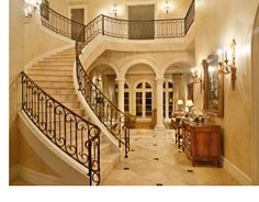 Curving marble staircase in French style home, Austin, Texas