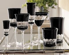 To make the pattern, black crystal is layered over clear crystal, then gently cut away to create the unique, oval-banded pattern. It makes a stunning presentation of liquors, though red wines and red cocktails look particularly elegant against the black. Crystal Wine Glasses, Crystal Glassware, Champagne Glasses, Cut Glass, Glass Art, Bandeja Bar, Kitchenware, Tableware, Serveware