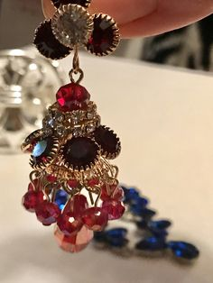 These gorgeous pierced earrings are gold tone or plate with red and sparkling ice rhinestones and carnival cranberry crystals. They are 2 1/2. Stunning earrings! I add new backs to all earrings unless they are made special & all purchase arrive gifted nicely 🎀 These are pristine ✨