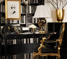 Black, white and gold interior. The upholstered chair is just the right amount of glam!