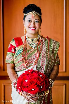 The bridal bouquet of red roses with pearl centers coordinates gorgeously with her saree   Chicago Marriott Southwest At Burr Ridge   Sapan Ahuja Photography