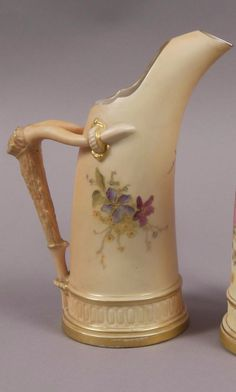 A ROYAL WORCESTER TUSK DECORATED IN BLUE FLOWERS ICE JUG