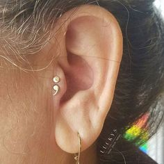 This lovely client had been contemplating a semicolon tattoo, but wasn't sure if a tattoo was the right choice for her. Then she saw this rad semicolon jewelry and had her answer! Double tragus done by @zwpiercing #luckysnoho #northamptonma
