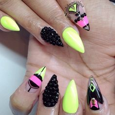 Neon Pink, Yellow, and Black Negative Space Stiletto Nails With Black Rhinestones.