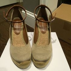 BCBG tan wedges BCBG tan wedges. Brand new. Never worn. Straps around the ankle. Size 8/38. There is a small scratch on the back of the left wedge as show in last picture. Looks like something in my closet got to it. Still excellent condition. BCBG Shoes Wedges