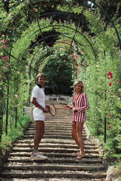 Jack and GeeGee Entz beneath the rose-canopied steps which lead to the entrance of the tennis courts at the Villa d'Este at Tivoli, near Rome, Italy, circa Photo Slim Aarons Slim Aarons, Old Money, Mode Vintage, Vintage Italy, Vintage Vibes, Attractive People, Hotel Decor, Design Hotel, Coors Light