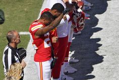 Kansas City Chiefs cornerback Marcus Peters raises his fist in the air during the national anthem on Sunday, September 11.