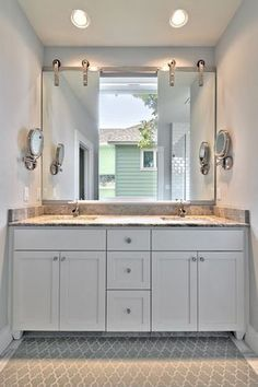 mirror over window bathroom transitional with two sinks lighted makeup mirrors