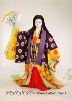 A woman dressed in junihitoe at a kimono photography experience. #heian…