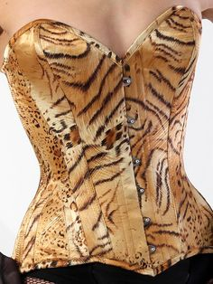 Holy wow. A tiger print corset? Gimme. Via: What Katie Did
